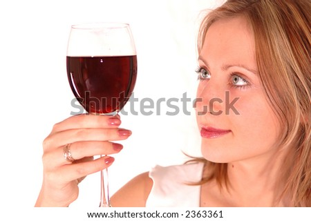young woman with glass of wine isolated on white
