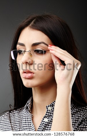 Young woman with glasses - stock photo