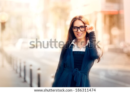 Young Woman with Glasses Out in the City - Beautiful young woman with glasses out in the city  - stock photo