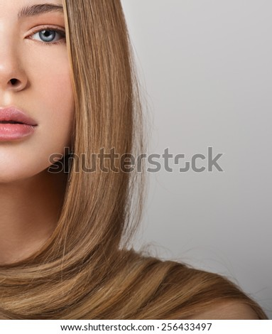 Young woman with gorgeous beautiful long straight hair. Blond Hair.