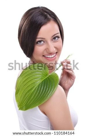 young woman with green leaf over white - stock photo