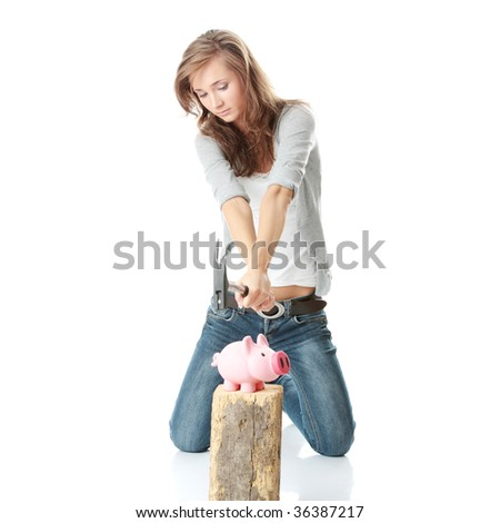 Young woman with hammer about to smash piggy bank to get at corporate savings