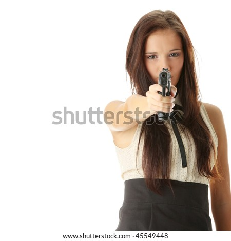 Young woman with hand gun isolated on white background - stock photo