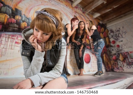 Young woman with hand on face near group - stock photo