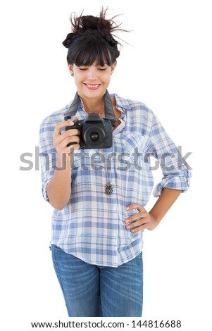 Young woman with hand on her hip taking picture on white background