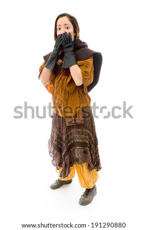 Young woman with hand over her mouth - stock photo
