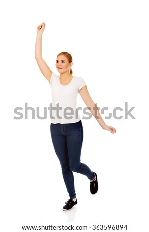 Young woman with hand up - stock photo
