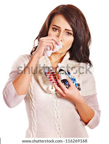 Young woman with handkerchief having  tablets and pills.  Isolated. - stock photo