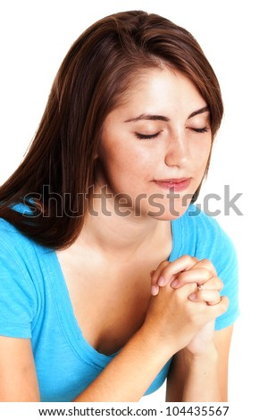 Young woman with hands clasped in prayer