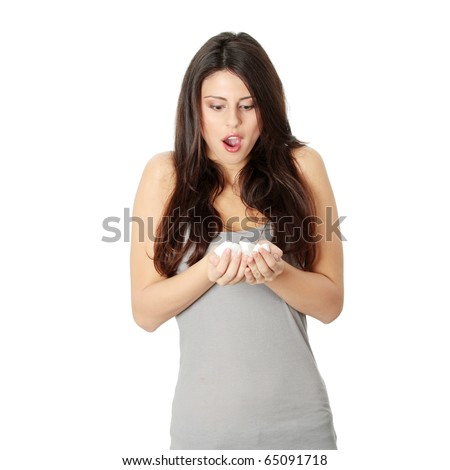 Young woman with hands full of sugar, isolated on white.