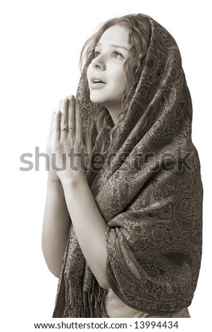 young woman with hands in praying, isolated on white