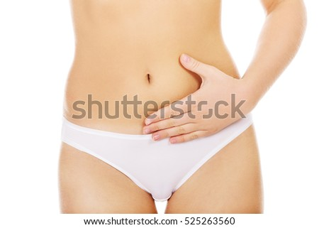 Young woman with hands on belly-stomach ache.