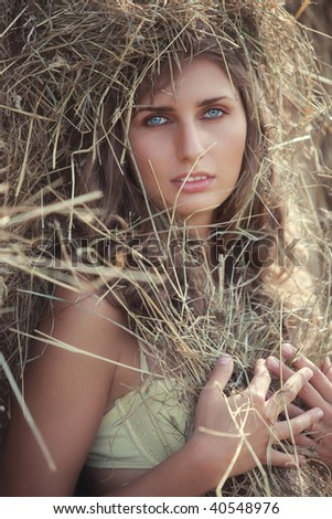Young woman with hay portrait. - stock photo