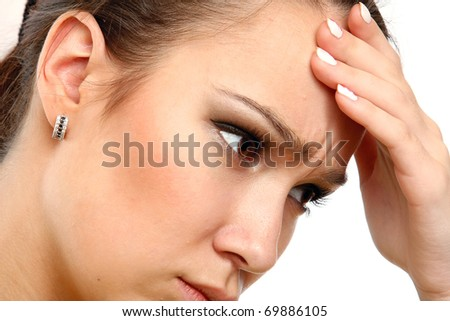 Young woman with head pain over white background - stock photo