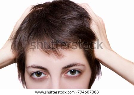 Young woman with headache close-up on a white background