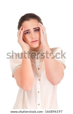 Young woman with headache holding head isolated on white background/Woman holding head in pain over white background.