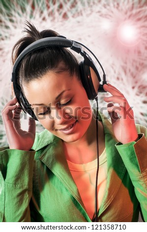 Young  woman with headphone listening to music - stock photo