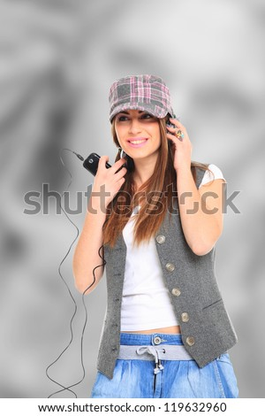 Young woman with headphones listening to music - stock photo