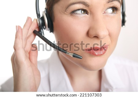 Young woman with headset and white shirt has problems to understand the caller