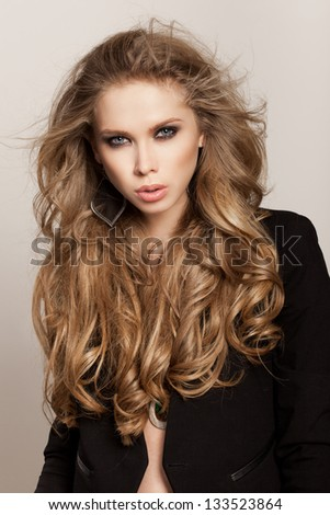 Young woman with healthy long hair and fresh makeup. Wavy Hair. Hairstyle. Not isolated on background. - stock photo