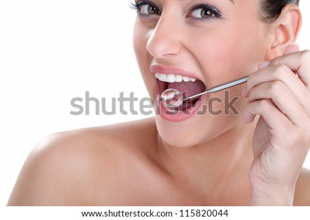 young woman with healthy teeth and dental mirror - stock photo