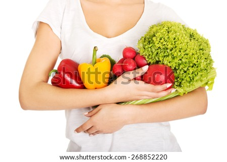 Young woman with healthy vegetables. - stock photo