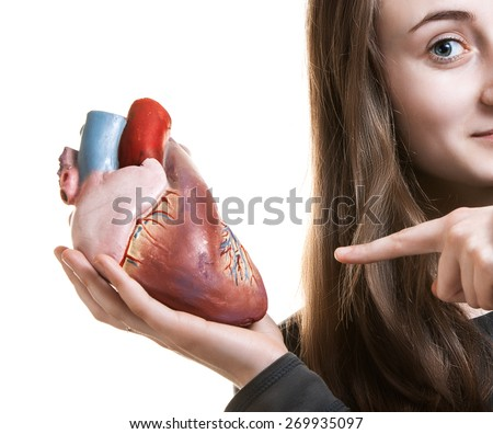Young woman with heart in hand. Abstract creative background
