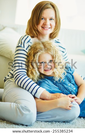 Young woman with her daughter