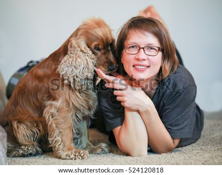 young woman with her English cocker spaniel
