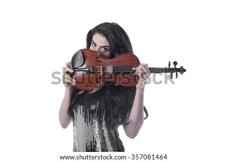 young woman with her face from nose down behind the violin
