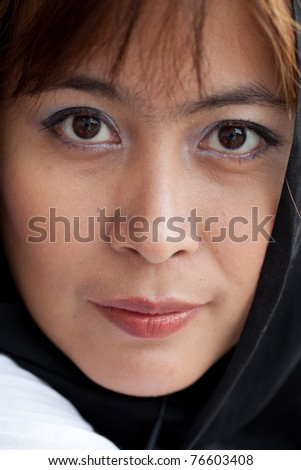 young woman with her veil around her face