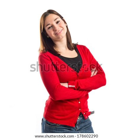 Young woman with hers arms crossed over white background