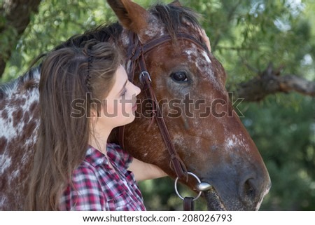 Young woman with horse, close up portrait