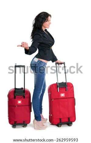 Young Woman with huge luggage hitchhiking while going on vacations