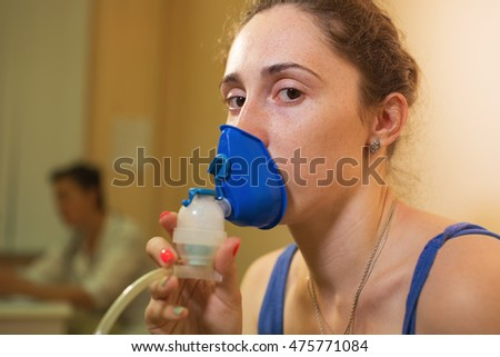 Young woman with inhaler