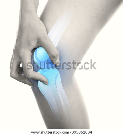 Young woman with knee pain isolated on white - stock photo