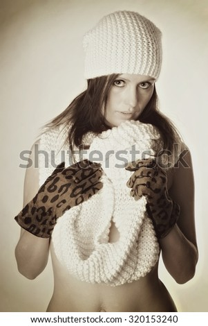 young woman with knitted hat and knitted scarf / Winter clothes