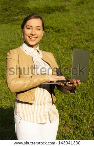 Young woman with laptop. - stock photo