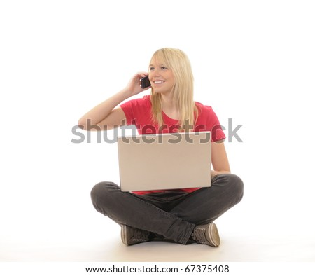 young woman with laptop and mobile phone - stock photo