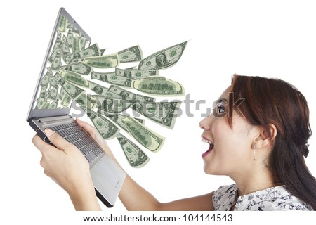 Young woman with laptop and money in great on-line business
