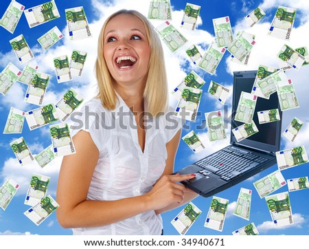 young woman with laptop and money in great on-line business - stock photo
