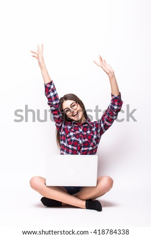 young woman with laptop computer celebrating success, isolated on white. - stock photo