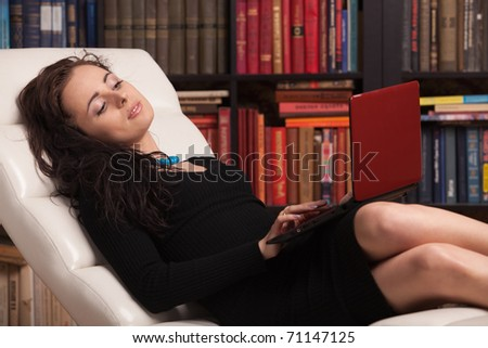 Young woman with laptop in the living room at home. - stock photo