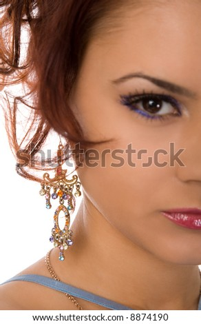young woman with large ear-ring on white background