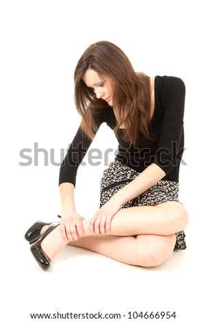 young woman with legs pain, full length, white background - stock photo
