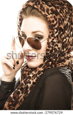 Young woman with leopard pattern scarf and sunglasses, isolated on white - stock photo