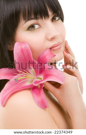 Young woman with lily flower