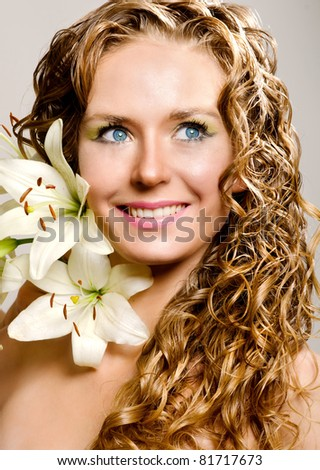 Young woman with lily flowers