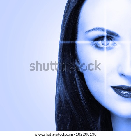 Young woman with lines scanning the eye. Medicine or biometric concept - stock photo