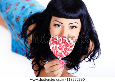Young woman with lolipop candy - stock photo